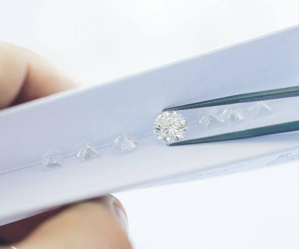 Diamond being held by tweezers