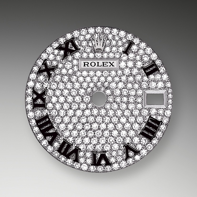 The diamond-paved dials are a sparkling symphony to enhance the watch and enchant the wearer. Gem-setters finely carve the precious metal to hand-shape the seat in which each gemstone will be perfectly lodged. Besides the intrinsic quality of the stones, several other criteria contribute to the beauty of Rolex gem-setting: the precise alignment of the height of the gems, their orientation and position, the regularity, strength and proportions of the setting as well as the intricate finishing of the metalwork.