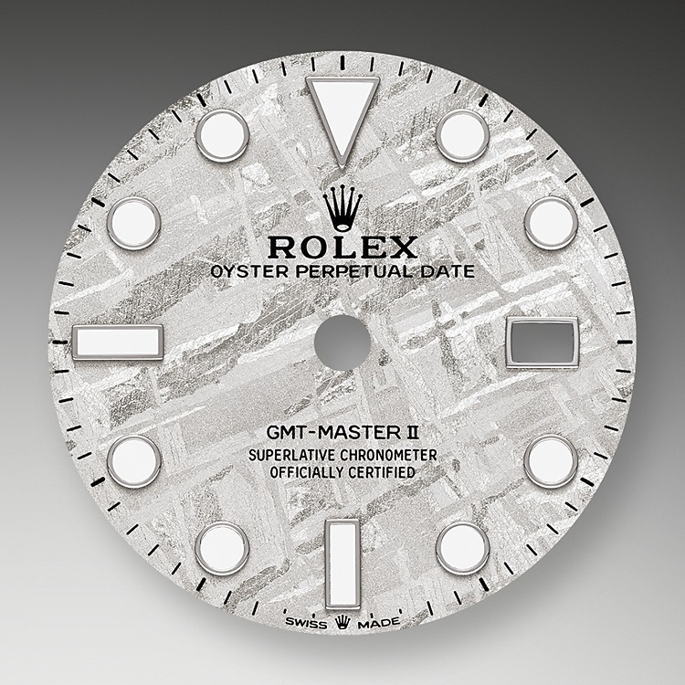 This model is the only GMT-Master II with a meteorite dial. Meteorite comes from the heart of an asteroid or possibly even a planet that has exploded, propelling material across the Solar System until chance brings it into our planet's orbit and gravity pulls it to Earth. During its journey, the centre of the meteorite is gradually transformed, producing highly unusual metallic patterns, resulting from the very slow cooling of molten asteroid cores. The designers at Rolex create from these configurations a unique treasure for some of the most prestigious models, including this GMT-Master II.