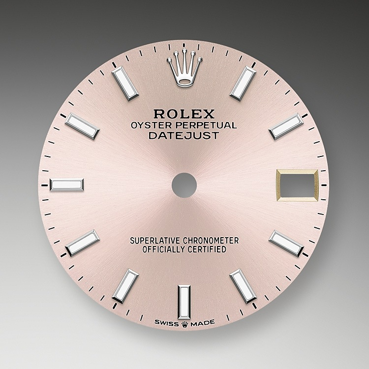 The sunray finish creates delicate light reflections on many dials in the Oyster Perpetual collection. It is obtained using masterful brushing techniques that create grooves running outwards from the centre of the dial. Light is diffused consistently along each engraving, creating a characteristic subtle glow that moves depending on the position of the wrist.<br>Once the sunray finish has been completed, the dial colour is applied using Physical Vapour Deposition or electroplating. A light coat of varnish gives the dial its final look.
