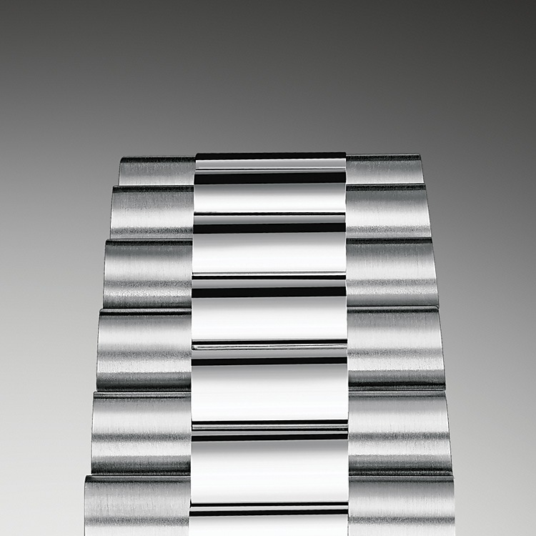 The design, development and production of Rolex bracelets and clasps, as well as the stringent tests they face, involve advanced high technology. And, as with all the components of the watch, aesthetic controls by the human eye guarantee impeccable beauty.  The President bracelet, with its semi-circular three piece links, was created in 1956 for the launch of the Oyster Perpetual Day-Date. It represents the ultimate in refinement and comfort and is always made of carefully selected precious metals.