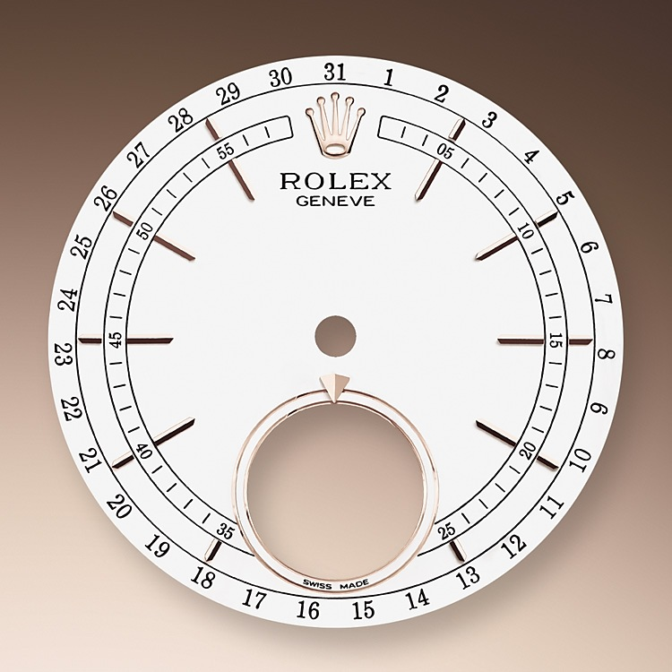 The Cellini Moonphase has a white lacquer dial with a blue enamelled disc at 6 o'clock showing the full moon and the new moon, the former depicted by a meteorite applique and the latter by a silver ring. The moonphase is read via the indicator set at 12 o'clock on the subdial, as the full moon and new moon rotate through the lunar cycle. The Cellini Moonphase also displays the date around the circumference of the dial, via a centre hand with a crescent moon at its tip.